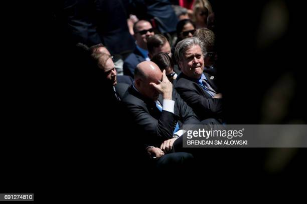 National Economic Council Director Gary Cohn and strategist Steve Bannon wait with others to hear US President Donald Trump announce the US will...