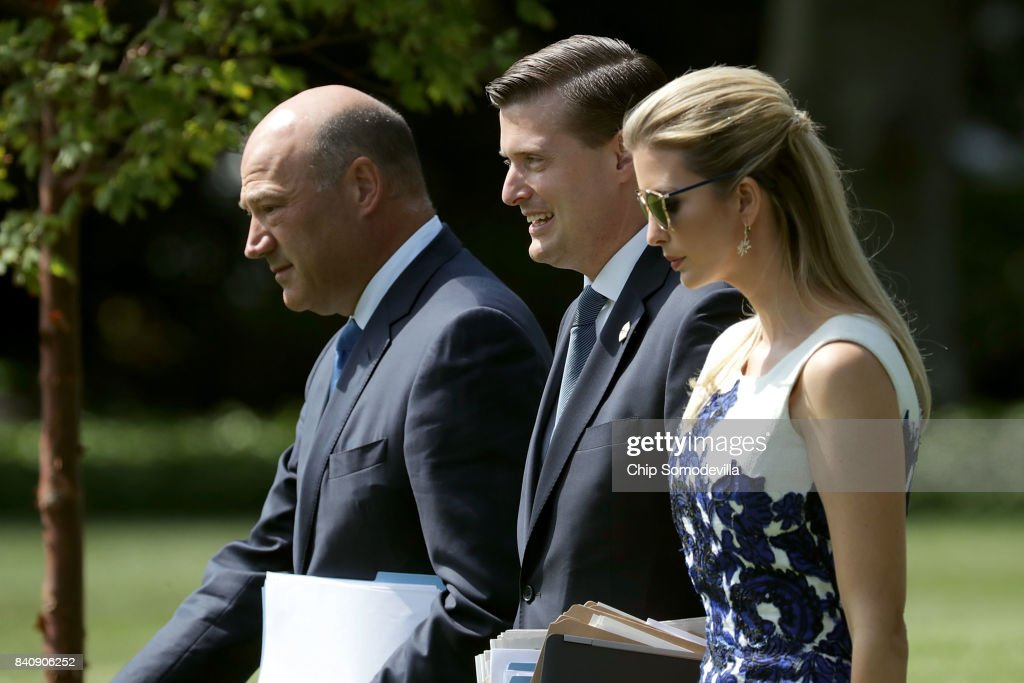 National Economic Council Director Gary Cohn, White House Staff Secretary Rob Porter and Ivanka Trump walk across the South Lawn before departing the White House with U.S. President Donald Trump August 30, 2017 in Washington, DC. Trump is taking a day trip to Springfield, Missouri, to participate in a 'tax reform kickoff event,' according to the White House.