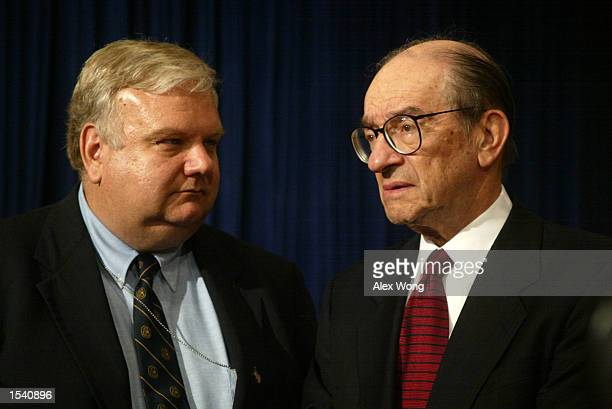 National Economic Council Director Larry Lindsey talks to Federal Reserve Board Chairman Alan Greenspan during a White House event to pay tribute to...
