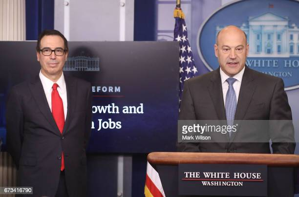 National Economic Director Gary Cohn speaks while flanked by Secretary of the Treasury Steven Mnuchin during a briefing about President Trump's new...