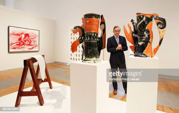 """National Endowment for the Humanities chairman William """"Bro"""" Adams studies glazed earthenware sculptures by artist Betty Woodman while touring the..."""