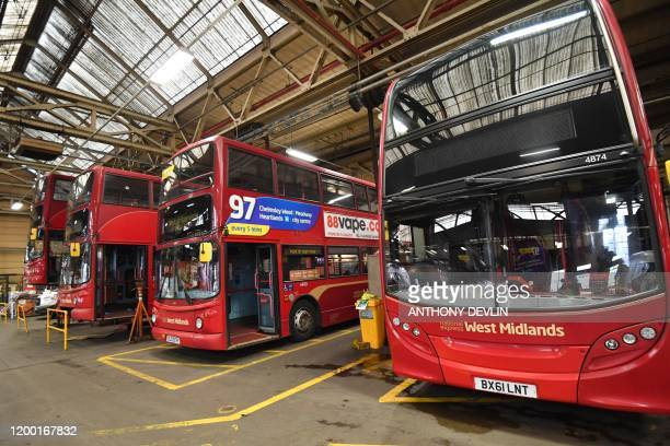 National Express Group busses are pictured at Birmingham Central Bus Garage in Birmingham central England on February 11 during a visit by Britain's...