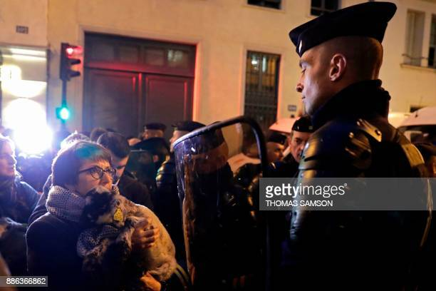 National Federation of Agricultural Holders' Unions President Christiane Lambert faces antiriot policemen as she waits outside the Hotel de Matignon...