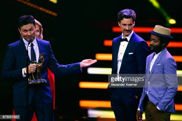 'National Film' Award Winner Simon Verhoeven speaks on stage with Palina Rojisnki Florian David Fitz Eric Kabongo during the Bambi Awards 2017 show...
