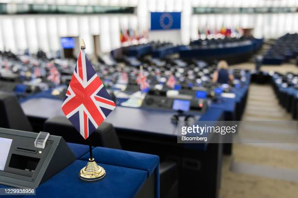 National flag, also known as a Union Jack, sits on the empty desk of a Member of European Parliament inside the European Parliament in Strasbourg,...