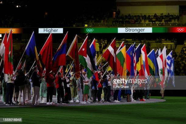 National flag bearers enter the stadium during the Closing Ceremony of the Tokyo 2020 Olympic Games at Olympic Stadium on August 08, 2021 in Tokyo,...
