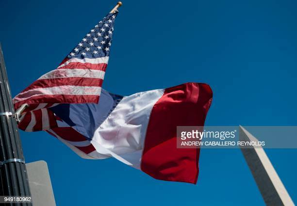 A US national flag French flag and WashingtonDC flag fly near the Washington Monument in Washington DC on April 20 the week before the visit of...