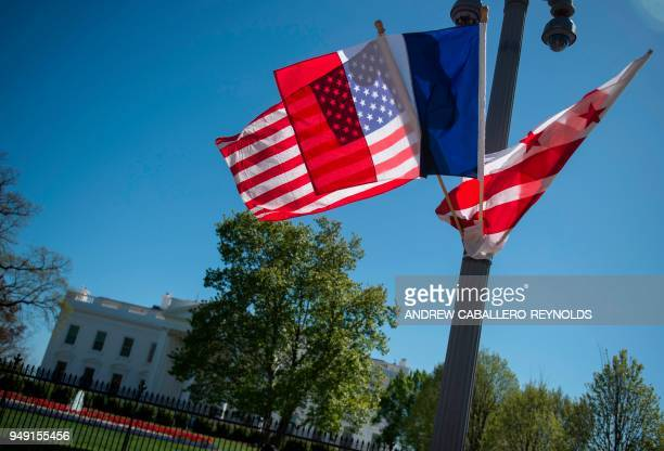 A US national flag French flag and WashingtonDC flag fly near the White House in Washington DC on April 20 the week before the visit of French...