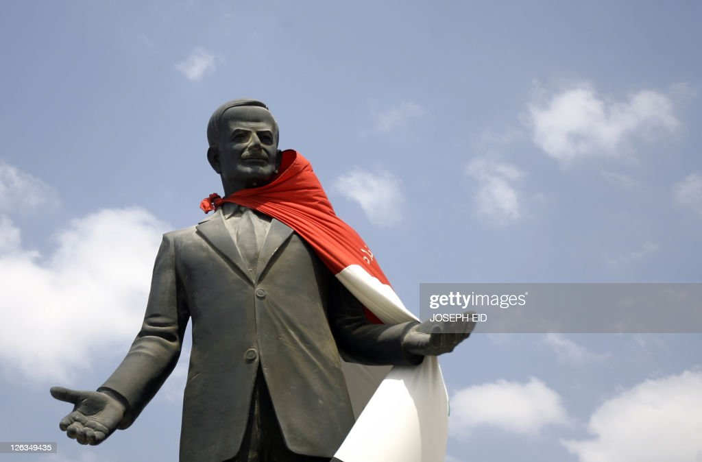 A national flag hangs on a statue of Syr : News Photo