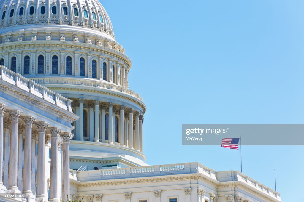 U.S. National Flag in Front of U.S. Capitol in Washington DC : Stock Photo