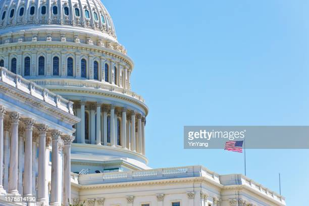 u.s. national flag in front of u.s. capitol in washington dc - government building stock pictures, royalty-free photos & images