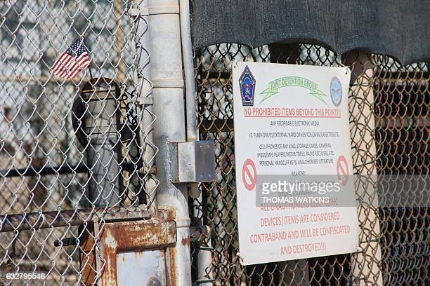 A US national flag is placed in the fencing of Camp 5 at the US Military's Prison in Guantanamo Bay Cuba on January 26 2017 President Donald Trump...
