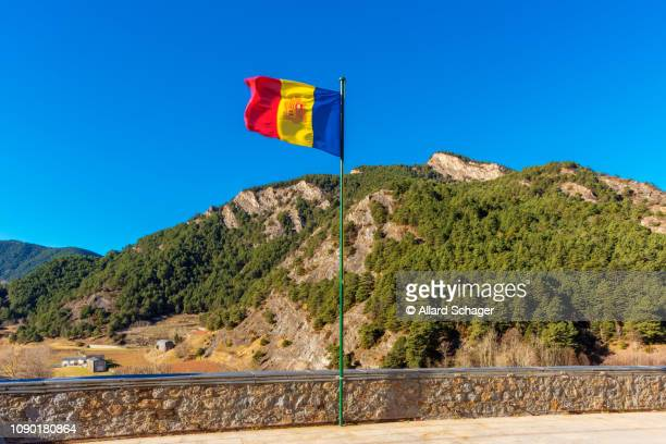 national flag of andorra waving in village of ordino andorra - andorra stock pictures, royalty-free photos & images