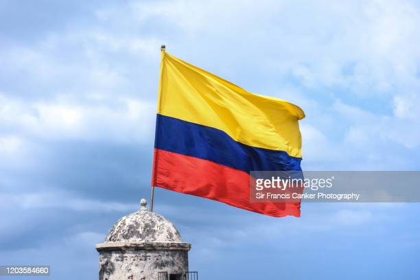 national flag of colombia waiving against dramatic sky in cartagena de indias, colombia - colombia foto e immagini stock