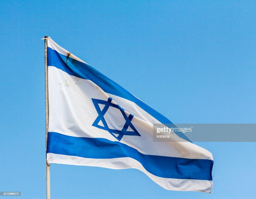 National Flag of Israel against blue sky : Stock Photo
