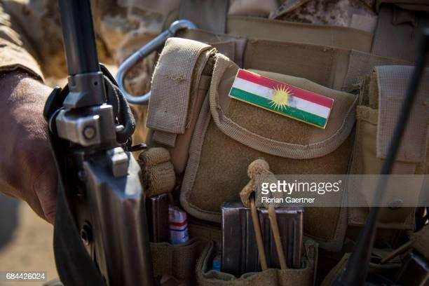 National flag of Kurdistan on a uniform of a Kurdish soldier on April 20 2017 in Bashiqa Iraq