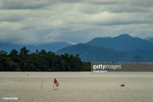National flag of Malaysia or 'Jalur Gemilang' at lake Bukit Merah in Malaysia.