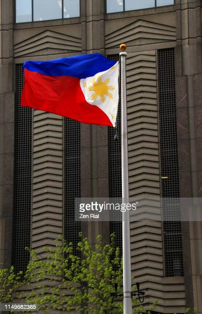 national flag of the republic of the philippines on a flagpole waves with the wind - philippines flag stock pictures, royalty-free photos & images