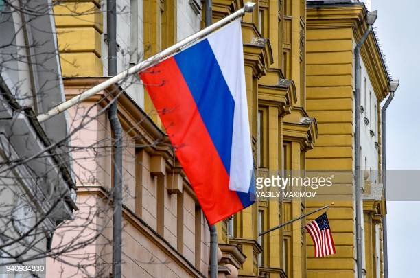 US national flag waves on the building of the embassy of the United States of America in Moscow on April 2 2018 Russian Foreign Minister Sergei...