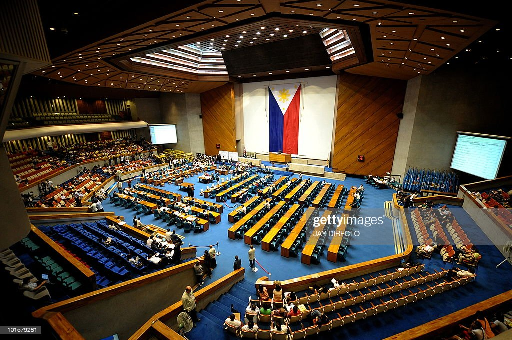 A national flage is draped in the plenary hall venue of the resumption of national canvassing for the May 10 presidential elections at the House of Representatives in Quezon City suburban Manila on June 3, 2010. Benigno Aquino could be officially declared winner of the Philippine presidential election on June 15, senior legislators said, despite ongoing inquiries into alleged vote cheating. An unofficial count of over 90 percent of the votes has given the 50-year-old Aquino an insurmountable lead and almost all of his major rivals have conceded to him, but by law only the parliament can declare the winner.