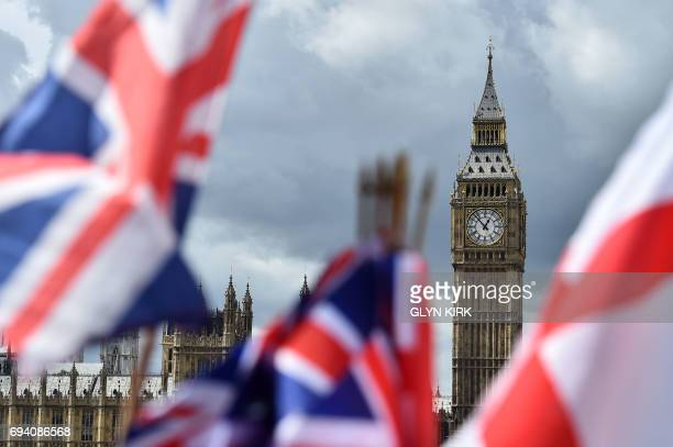 National flags flutter near the The Elizabeth Tower commonly referred to as Big Ben in central London on June 9 2017 British Prime Minister Theresa...