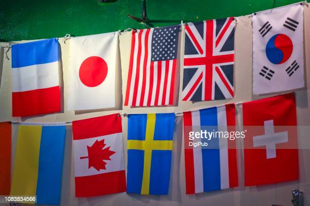 national flags hanging on the wall - national flag stock photos and pictures