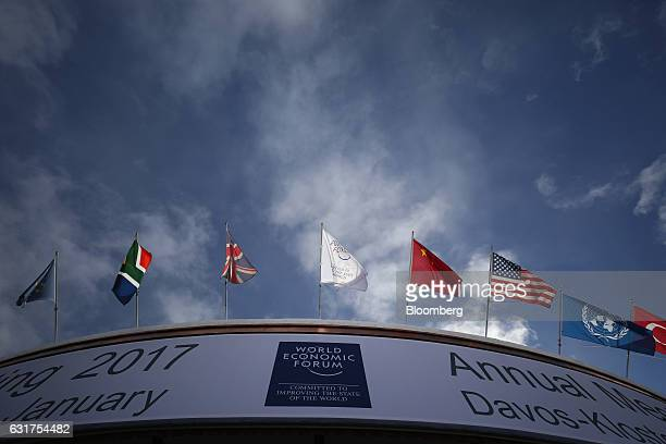 National flags including those of China the US and the UK hang above the front of the Congress Center the venue for the World Economic Forum in Davos...
