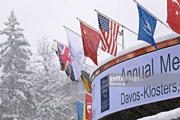 National flags of China United States United Kingdom and Turkey right hang above the front of the Congress Center the venue for the World Economic...