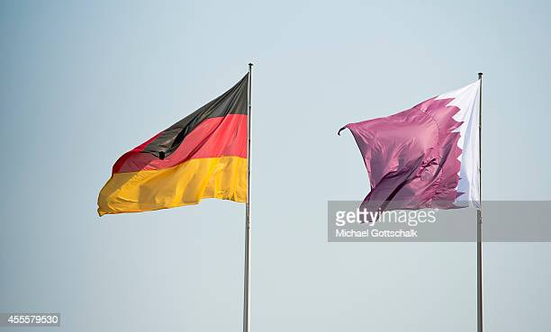 National Flags of Germany and Qatar at German chancellery on September 17 2014 in Berlin Germany The Qatari monarch known for his support of sporting...