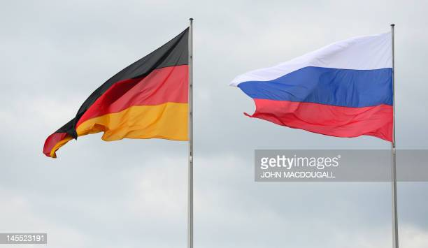 National flags of Germany and Russian Federation are displayed in front of the Chancellery in Berlin on June 1 where Russian President is to visit...