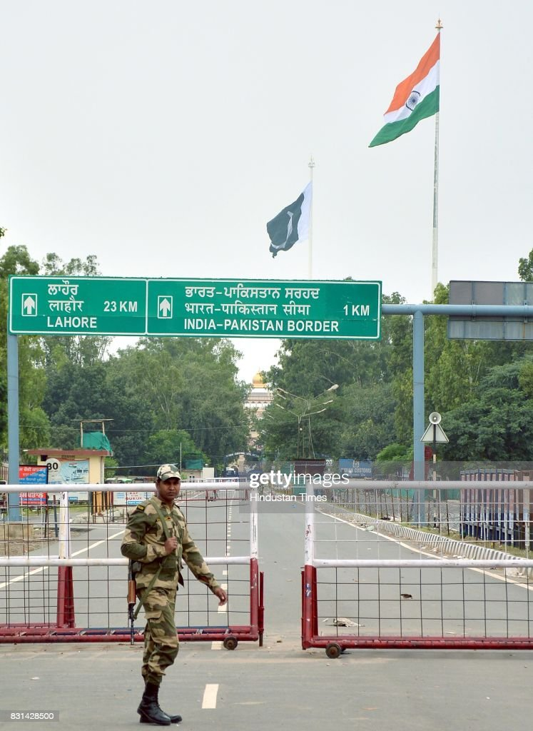 National flags of India and Pakistan fluttering on the both side of IndoPak International Border at Wagah on August 14 2017 near Amritsar India