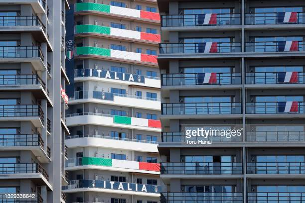 National flags of Italy and France hanging on residential buildings in the athletes' village for the Tokyo Olympics on July 18, 2021 in Tokyo, Japan.