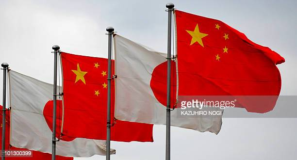National flags of Japan and China are displayed at Tokyo's Haneda Airport on May 30 2010 Chinese Premier Wen Jiabao is on a threeday visit to Japan...