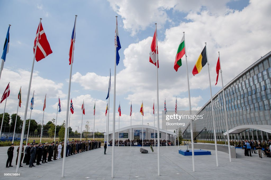 National flags of member states fly during the welcoming ceremony at the North Atlantic Treaty Organization (NATO) summit at the military and political alliance's headquarters in Brussels, Belgium, on Wednesday, July 11, 2018. President Donald Trump opened up another front in his tussle with allies on his arrival at NATOs annual summit, targeting Germany over its support for the Nord Stream 2 gas pipeline from Russia. Photographer: Marlene Awaad/Bloomberg via Getty Images