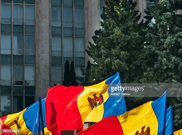 national flags of moldova in front of government - chisinau stock pictures, royalty-free photos & images