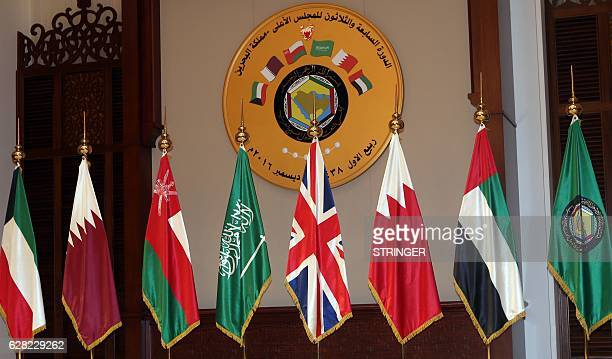 National flags of the Gulf Cooperation Council members and a British flag are displayed during a summit on December 7 in the Bahraini capital Manama...