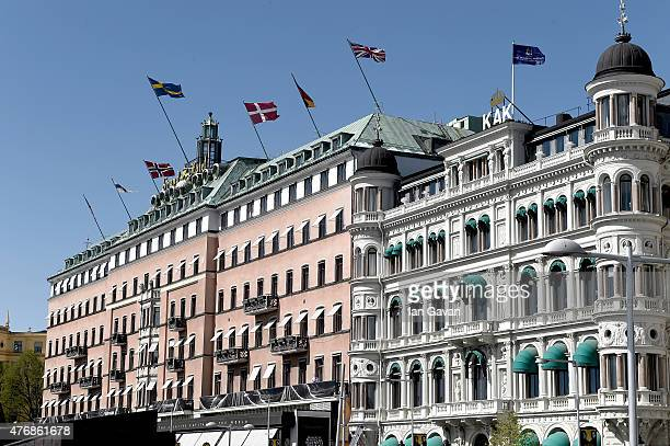 National flags wave on top of The Grand Hotel as preparations continue before the royal wedding of Swedish Prince Carl Philip and his fiancee Sofia...