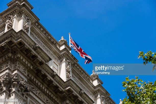 uk national fly on top of downing street building - prime minister stock pictures, royalty-free photos & images