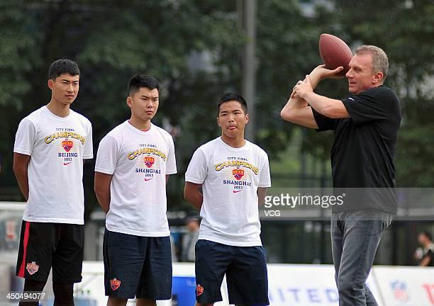 US National Football League former quarterback Joe Montana attends a quarterback clinic during 2013 NFL University Flag Football League at Tianhe...