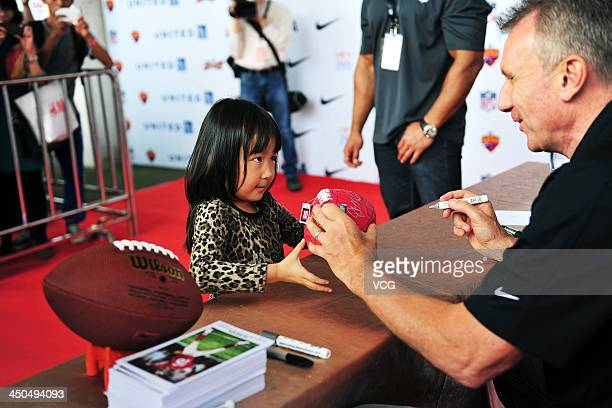 US National Football League former quarterback Joe Montana attends signiture conference during 2013 NFL University Flag Football League at Tianhe...