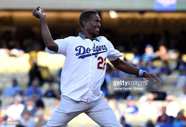 National Football League Hall of Fame defensive back Mike Haynes throws out the first pitch before the game between the Los Angeles Dodgers and the...