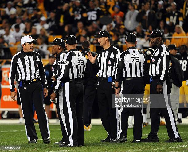 National Football League officials including referee Pete Morelli line judge Carl Johnson field judge Jon Lucivansky head linesman Dana McKenzie side...