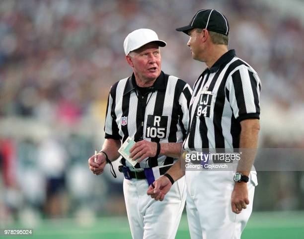 National Football League officials referee Dick Hantak and line judge Mark Steinkerchner discuss a play during a preseason game between the St Louis...