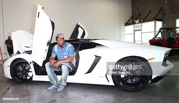 National Football League player Marshawn Lynch poses in his 2013 Lamborghini Aventador Roadster equipped with Monster Sound at Findlay Customs on May...