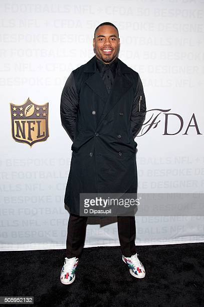 National Football League player Rashad Jennings poses on the carpet as the NFL Unveils Super Bowl 50 Bespoke Designer Footballs in Collaboration with...