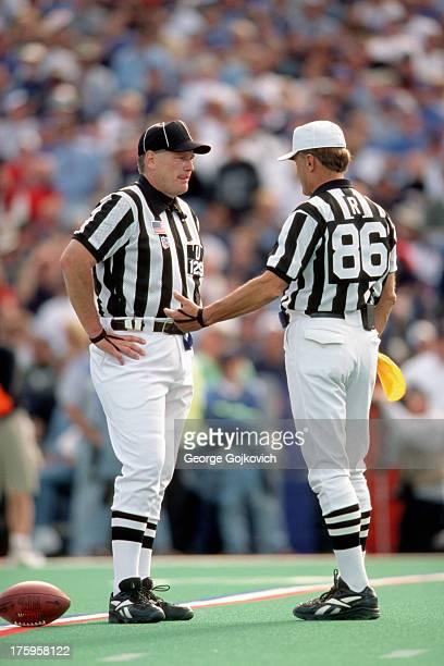 National Football League referee Bernie Kukar talks with umpire Bill Schuster during a game between the Oakland Raiders and Buffalo Bills at Ralph...