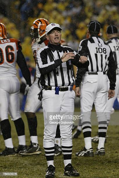 National Football League referee Bill Carollo signals during a game between the Cincinnati Bengals and Pittsburgh Steelers at Heinz Field on December...
