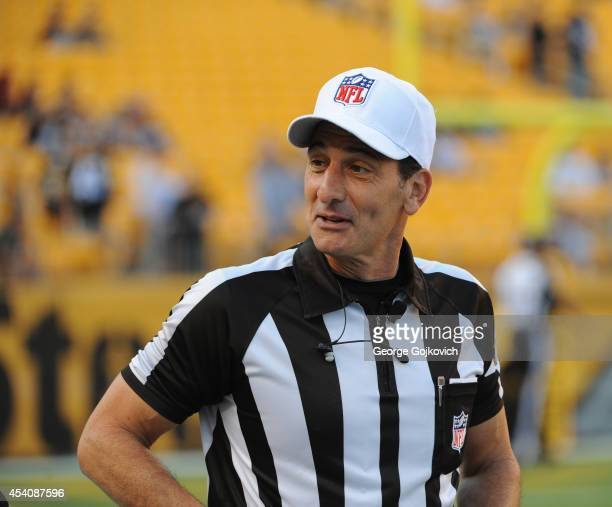 National Football League referee Gene Steratore looks on from the field before the start of a preseason game between the Buffalo Bills and Pittsburgh...