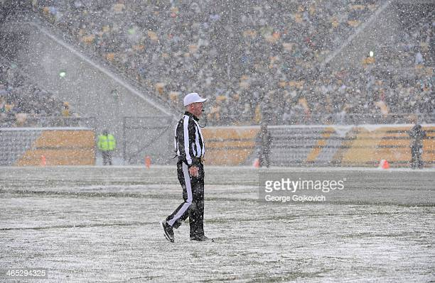 National Football League referee John Parry looks on from the field during a game between the Miami Dolphins and Pittsburgh Steelers as snow falls at...