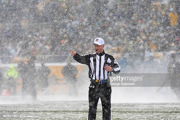 National Football League referee John Parry signals during a game between the Miami Dolphins and Pittsburgh Steelers as snow falls at Heinz Field on...